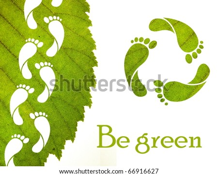 Footprint recycle sign and green leaf with foot carbon prints - stock photo