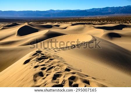 Footprints Along Dune at Death Valley - stock photo