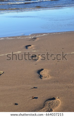 footprints by the sea