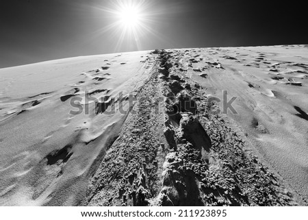 Footprints in sand dunes, Sahara, Morocco - stock photo