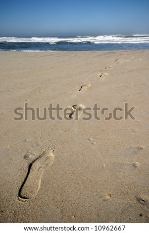 footprints in the beach - stock photo