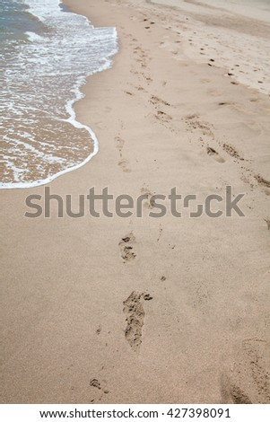Footprints in the sand at a beach