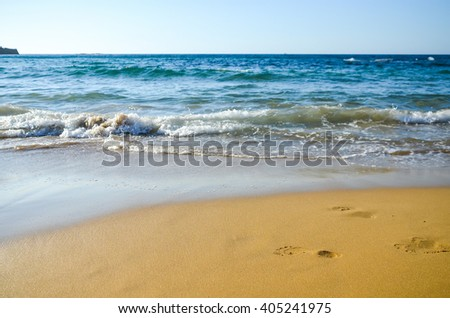 Footprints in the sand. Beach in Malia (Greece, Crete) - stock photo