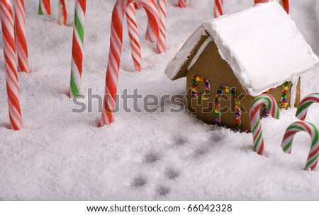 Footprints in the snow leading to Gingerbread cottage - stock photo