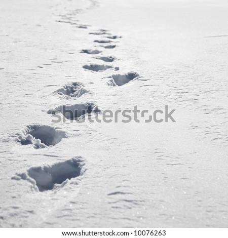 Footprints in white snow with copyspace on right