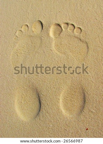 Footprints on sand (male and female)
