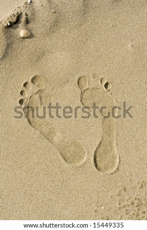 footprints on the beach - stock photo