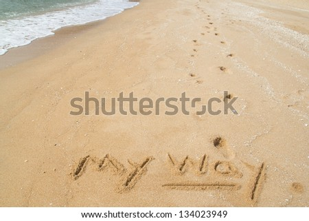Footprints on the beach and the word MY WAY. - stock photo