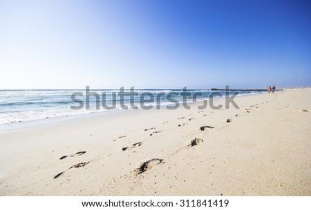 Footprints on the Costa Nova beach in Aveiro, Portugal - stock photo