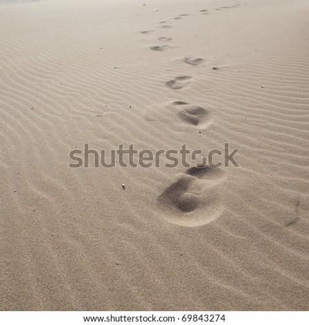 footprints on the sand - stock photo