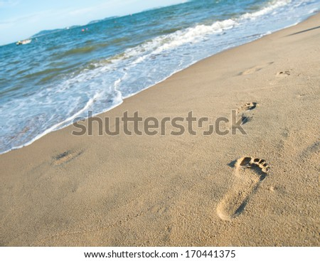 Footprints on the sand beach