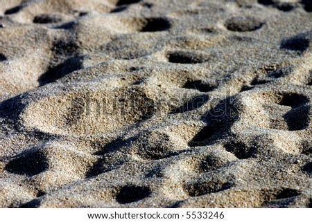 Footprints  over a sand - stock photo