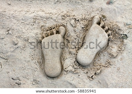 Footprints (white sand heel) - stock photo