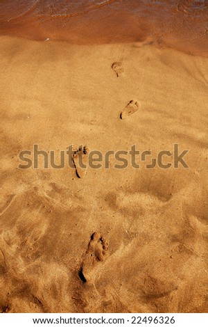 Footsteps in Sand - stock photo