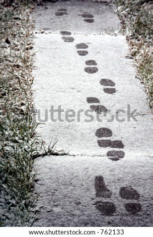 footsteps in snow - stock photo