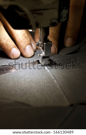 footwear part with single needle stitching operation - stock photo