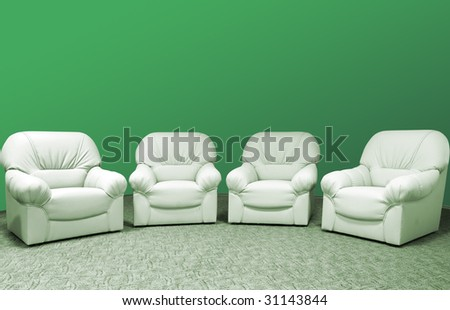 for green leather sofa in interior - stock photo