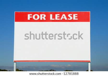 For lease sign against a neutral brick wall