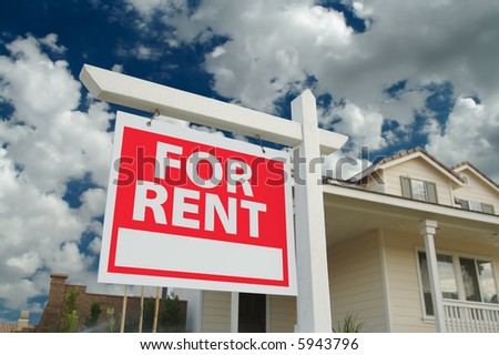 For Rent sign in front of new home. Dramatic Blue Sky and clouds behind. - stock photo