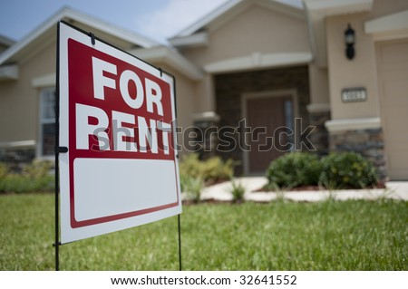 For Rent sign in front of new house - stock photo