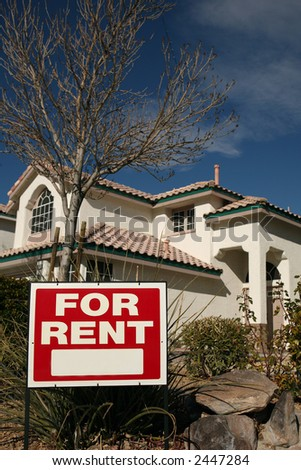 For Rent Sign with a House in the Background and Copy Space - stock photo