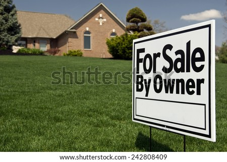 For Sale By Owner Sign In Front Of Nice Home - stock photo