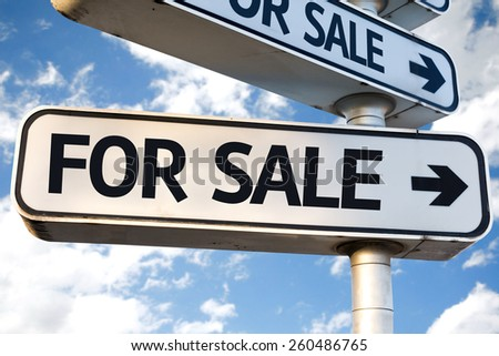 For Sale direction sign on sky background - stock photo