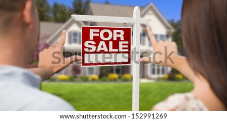 For Sale Real Estate Sign, House and Military Couple Framing Hands in Front.