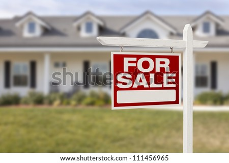 For Sale Real Estate Sign in Front of Beautiful New Home. - stock photo