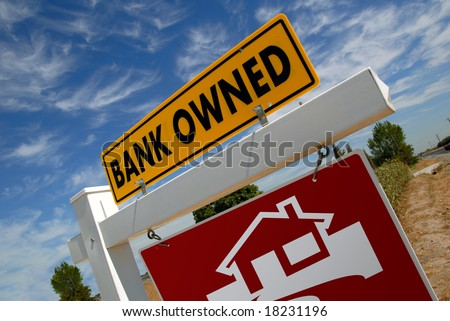 For Sale Real Estate Sign With Bank Owned Notice - stock photo