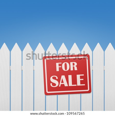 For sale sign on white wooden fence against the blue sky with copy space - stock photo
