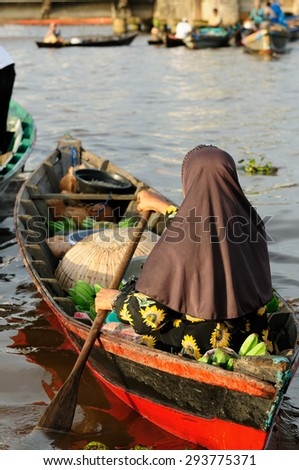 For seller on the floating market near the Banjarmasin city on the Martapura river. Indonesia, Borneo