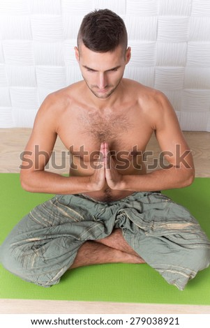 For this yogi man it seems like fitness, because there's a better way for you to train your body accomplished this with a yoga program. - stock photo