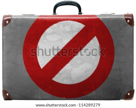 Forbidden sign painted on old grungy travel suitcase or trunk - stock photo