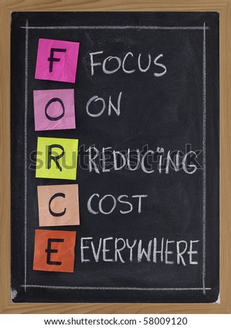 FORCE acronym (focus on reducing cost everywhere) - white chalk handwriting and color sticky notes on blackboard - stock photo