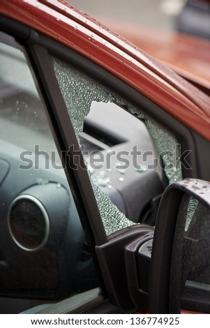 forced car windscreen and broken - stock photo