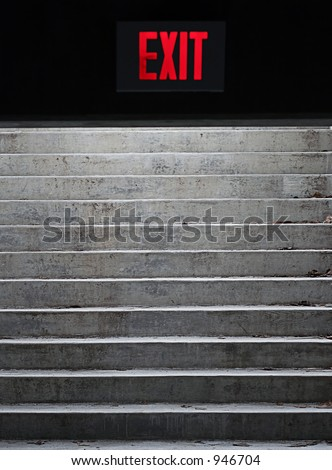 Foreboding exit sign at stairs. - stock photo