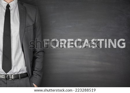 Forecasting concept on black blackboard with businessman