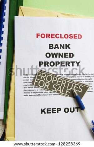 Foreclosed notice on a loan mortgage on a property. - stock photo