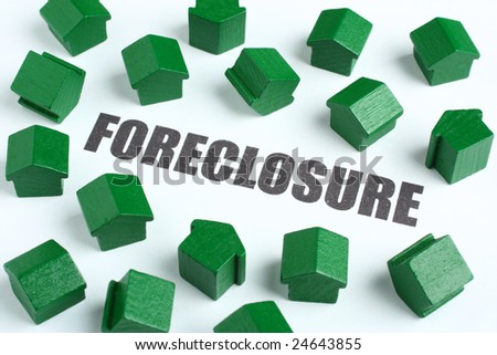 Foreclosure conceptual image with house tokens chaotically surrounding the word foreclosure - stock photo