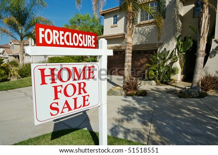 Foreclosure For Sale Real Estate Sign in Front of Beautiful New Home - stock photo