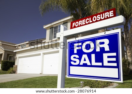 Foreclosure For Sale Real Estate Sign in Front of House. - stock photo