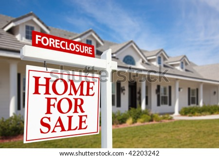 Foreclosure Home For Sale Real Estate Sign in Front of New House - stock photo