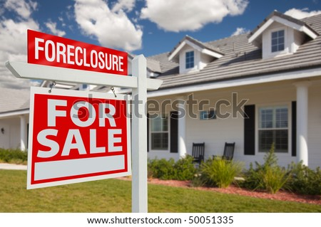 Foreclosure Home For Sale Real Estate Sign in Front of New House - Left Facing. - stock photo