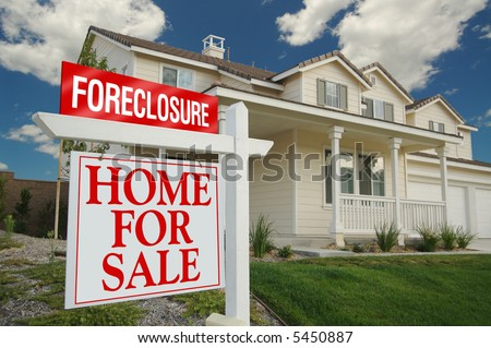 Foreclosure Home For Sale Sign and House with dramatic sky background. - stock photo