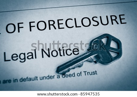 Foreclosure legal notice and house key macro in duotone - stock photo