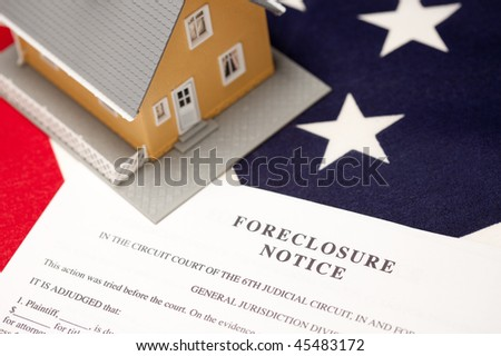 Foreclosure Notice and House on the American Flag with Selective Focus. - stock photo
