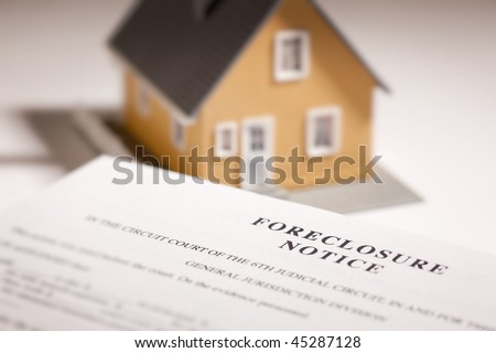 Foreclosure Notice and Model Home on Gradated Background with Selective Focus. - stock photo