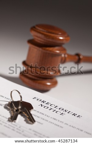 Foreclosure Notice, Gavel and House Keys on Gradated Background with Selective Focus. - stock photo