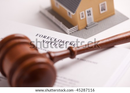 Foreclosure Notice, Gavel and Model Home with Selective Focus. - stock photo